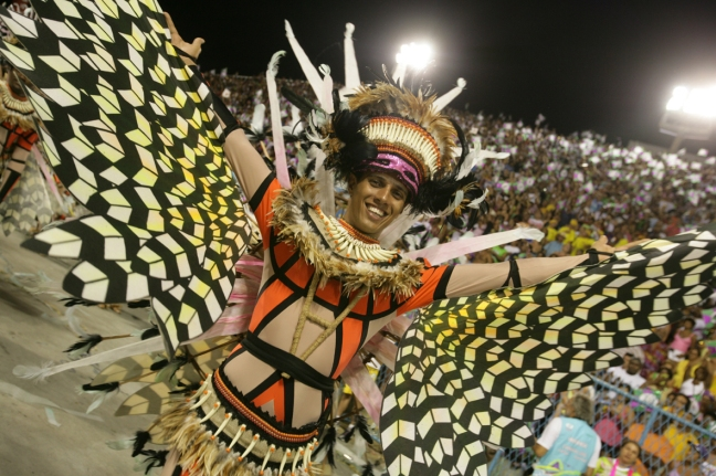 A dancer participates in the parade at the sambodrome